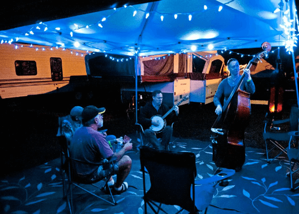 Musicians playing at night in the campgrounds