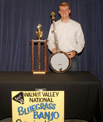 1st Place Banjo Winner, Hudsen Doucette, with Trophy & Prize Banjo