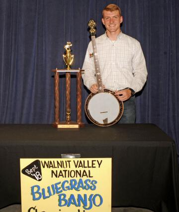 1st Place Banjo Winner, Hudsen Doucette, with Trophy & Prize Banjo