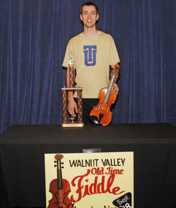 2nd Place Fiddle Winner, Josiah Colle with trophy and prize fiddle (2018)