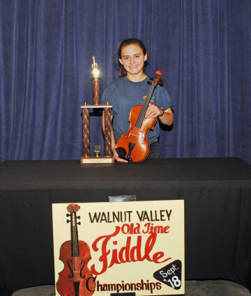 3rd Place Fiddle Winner, Maria McArthur with trophy and prize fiddle