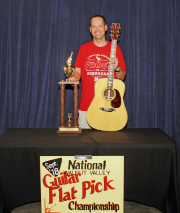 2nd Place Flat Pick Guitar Winner, Jason Shaw, with Trophy and Prize Guitar