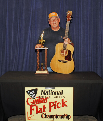3rd Place Guitar Winner, Roy Curry, with Trophy and Prize Guitar