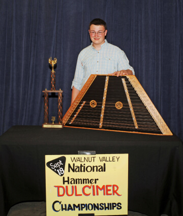 2nd Place Winner, Benjamin Barker, with Trophy and Prize Hammer Duclimer