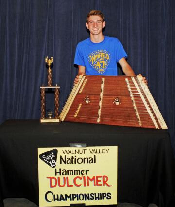 3rd Place Hammer Dulcimer Winner, Ben Haguewood, with Trophy and Prize Hammer Dulcimer