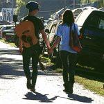 Couple holding hands walking toward bridge (Postcard front)