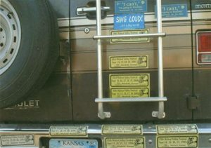 Walnut Valley Festival Bumper Stickers on the Back of a Camper Van