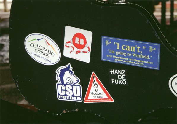 Guitar Case with Stickers (Postcard front)