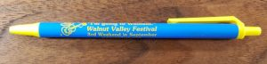 """Blue & Yellow pen with Walnut Valley Festival's """"Fesity"""" logo and """"I Can't. I'm going to Winfield."""""""