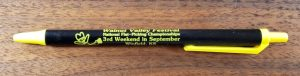 "Black and Yellow pen with Walnut Valley Festival's ""Fesity"" logo and contact information"