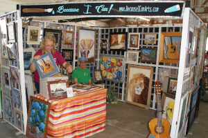 """""""Because I Can"""" booth selling paintings"""