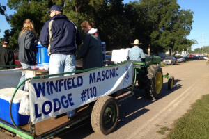 The Winfield Masonic Lodge selling donuts and coffee on the Johnny Popper Tractors