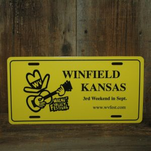 "Yellow Car Tag, reads ""Winfield, Kansas, 3rd Weekend in Sept., www.wvfest.com"""
