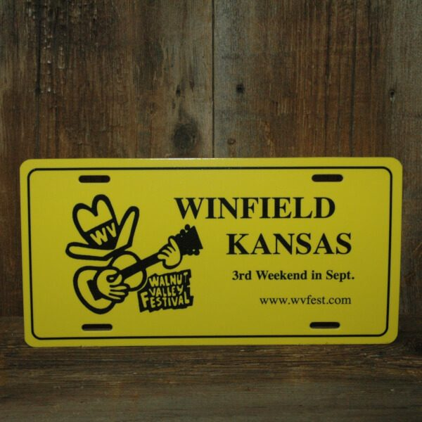 """Yellow Car Tag, reads """"Winfield, Kansas, 3rd Weekend in Sept., www.wvfest.com"""""""