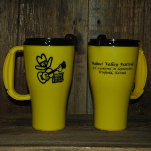 "Yellow WVF Coffee Mug--front shows Fesity, back reads ""Walntu Valley Festival, 3rd weekend in September, Winfield, Kansas"""