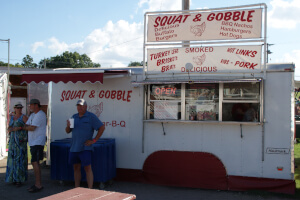 Squat & Gobble's smoked meats for sale on the festival midway
