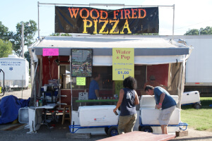 Wood fired pizza for sale on the festival midway