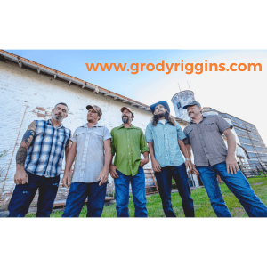 "Members of ""Grody Riggins"" standing in front of a grain elevator"