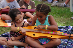 Kids learning new instruments at Feisty's Kids Music Camp