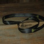 "Black lanyard with Feisty, reads ""Walnut Valley Festival, 3rd Weekend in September, Winfield, KS"""