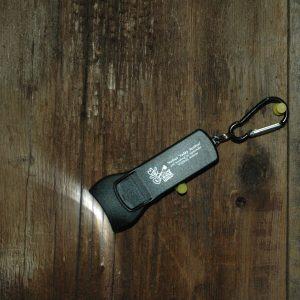 "Black LED, Keychain Flashlight, reads ""Walnut Valley Festival, 3rd Weekend in September, Winfield, Kansas"""