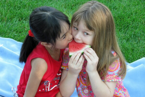 Girls sharing watermelon