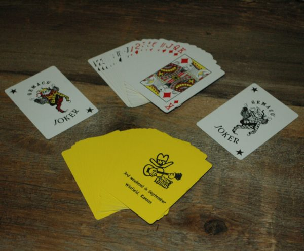 """Yellow Playing Cards with Fesity, reads """"Walnut Valley Festival, 3rd Weekend in September, Winfield, Kansas"""""""