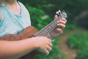 Girl playing ukulele